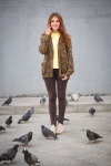 Girl Standing Near Birds