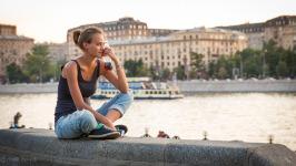 Girl  Sitting near River with Coke Bottle