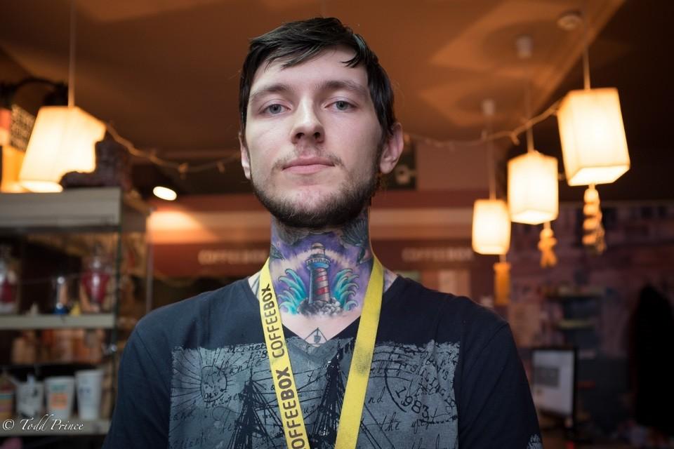 Roman: Barista with Tattoos
