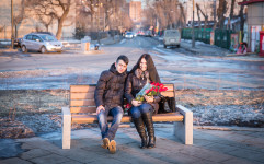 Artem and Yulia sitting on a bench near the seaside in Vladivostok