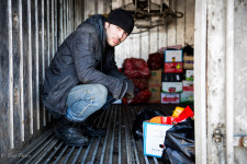 Dima, a Kyrgyzstan native, was helping load a truck with vegetables.