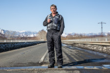 Dmitry standing along the new road from Yuzhno-Sakhalinsk to his town of Poronaysk.
