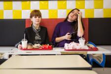 Sasha and Alina (right) eating at Royal Burger in Vladivostok.