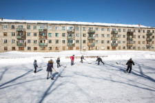 Russian children playing hockey in front of home on Sakhalin.