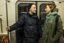 Sergei & Anna talking on the Moscow metro.