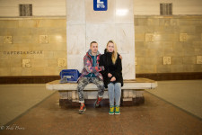 Ilya with his girlfriend at the metro station near their work.
