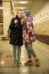 Ilya kissing his girlfriend in the Moscow metro.