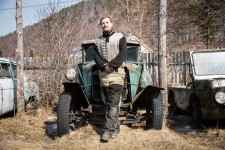Dmitry standing in front of the 1938 GAZ automobile, one of some 20 old cars he has collected over the years.