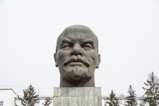 Medegma was standing across from the Lenin head as she waited for the bus.