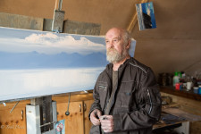 Vladimir standing next to one of his paintings-in-progress.