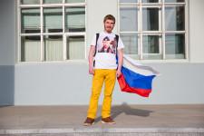 Daniil in his Putin shirt and Russian flag.
