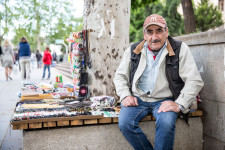 Giorgi, a former teacher, sells souvenirs on the streets of Tbilisi.