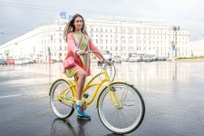 Serafima was crossing Nevsky on her bike after a short, but hard, rain storm.
