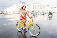 Serafima was dressed as colorfully as her bicycle.