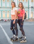 Yulia and Masha were rollerblading in front of the Hermitage in St. Petersburg.