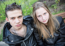 Timofei and Anna, 17, were sitting at a park in Moscow dressed in black leather coats.