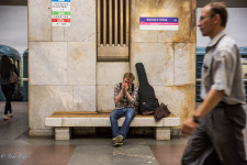 Dima playing the harmonica in the Moscow metro.