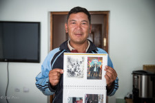 Kenjebek showing his family photo.