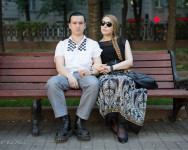 Mikhail, 24 and Natasha, 21, sitting at a Moscow park.