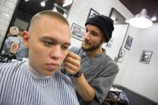 Danil at work at the barbershop.