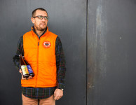 Dima holding bottles of his two craft beers.