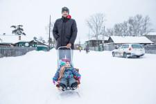 Daniil walking his daughter Olesya to day care.