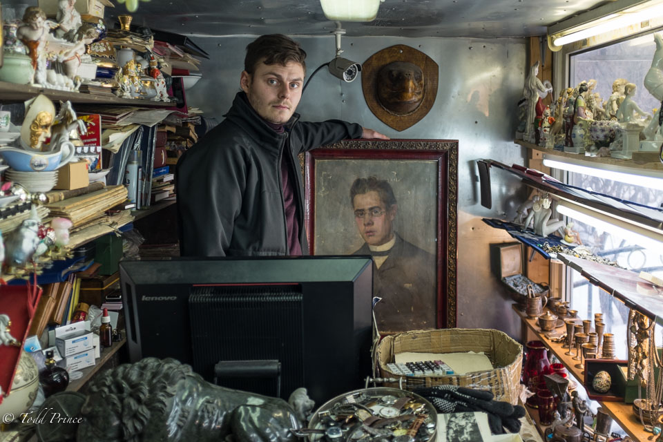 Alexei holding the 19th century painting that he won't sell until he knows more about it.