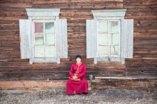 Ochar sitting in front of his living quarters at Datsan.