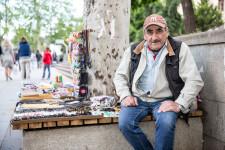 Giorgi, a former teacher, sells souvenirs on the streets of Tbilisi.