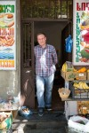 Giorgi standing in front of a convenience store in Tbilisi.