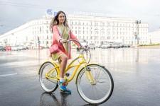 Serafima was crossing Nevsky on her bike after a short, but hard, rain storm.