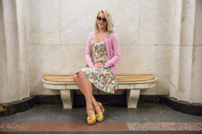 Alyona sitting in the Moscow metro.