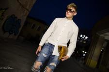 Denis was walking around in sunglasses at night.