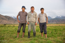 A Kyrgyz farmer with two of his four children.