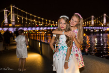 Maria, left, and her friend along the Moscow river.